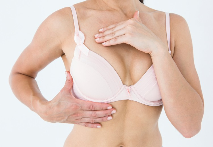 Image of a woman wearing a bra and examining her breast size