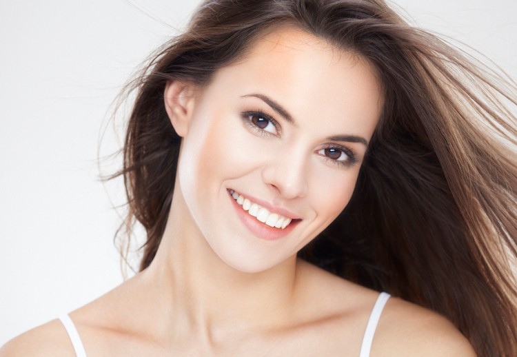 Image of beautiful brunette woman with perfect skin and perfect smile